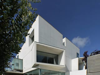 Casa 1+1=1: Casas de estilo  por joão teles barbosa arquitecto