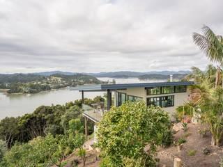 bouw woning New Zealand: modern  door Obliq Architectuur, Modern