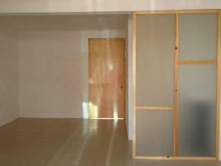 Living room by Urbe. Taller de Arquitectura y Construcción, Minimalist