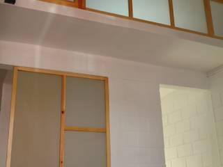 Dining room by Urbe. Taller de Arquitectura y Construcción, Minimalist
