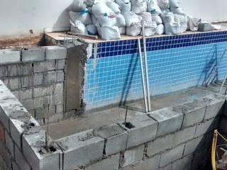 Ampliação de piscina. por Execcult Moderno
