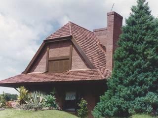 Casas de estilo  por CABRAL Arquitetos, Rústico