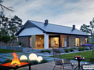 Projekt domu Daniel II G1 z wnętrzem pełnym słońca i ciepła : styl , w kategorii Domy zaprojektowany przez Pracownia Projektowa ARCHIPELAG,Nowoczesny