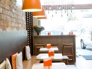 Padaria Pão Santo: Espaços gastronômicos  por DH Arquitetura,Moderno