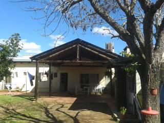 COCHERA: Casas de estilo  por Arq Mauricio Perdomo