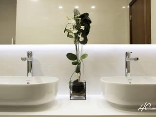 O PODER DE COMPARTIMENTAR: Casas de banho  por Grupo HC,Moderno