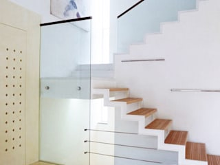 Modern corridor, hallway & stairs by roberto lazzeroni Modern