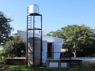 QUINCHO Y PILETA PARA PESCADORES: Casas de estilo  por DUA Arquitectos