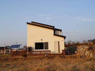 충남 천안 호당리 목조주택 (30py): 한다움건설의  주택