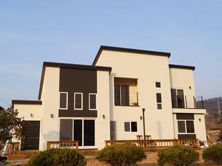 충남 천안 호당리 목조주택(35py): 한다움건설의  주택