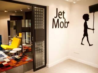 Jet Mob: Espaços comerciais  por V.ARQ - Soluções em Arquitetura Corporativa,Moderno