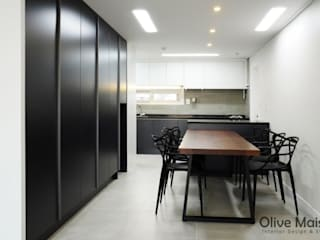 Dining room by Olive Maison, Modern