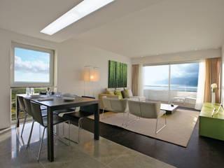 Moderne woonkamers van J.J. Silva Garcia, arquitecto Lda. Modern