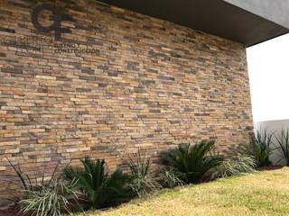 Detalle Muro Jardin Paredes y pisos de estilo moderno de GF ARQUITECTOS Moderno Piedra