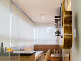 Varanda aconchegante por Flávia Diniz - Designer de Ambientes Moderno