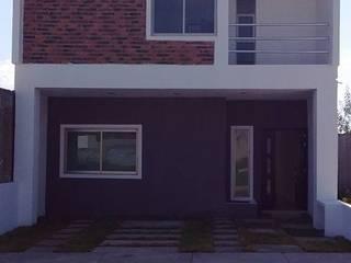 FACHADA 2: Casas de estilo  por + Ingenio Arquitectura y Diseño