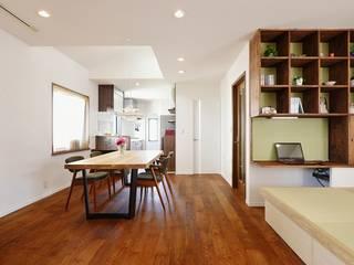 自然素材に包まれた家族が集まる2階リビング: 株式会社スタイル工房が手掛けたです。