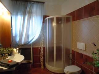 Villa Francesca- Cerveteri (RM)  relooking dependance destinata agli affitti brevi :  in stile  di Creattiva Home ReDesigner  - Consulente d'immagine immobiliare