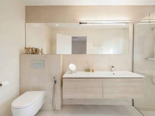 La casa de Marta: Baños de estilo  de Silvia R. Mallafré