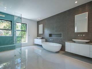 Baños de estilo  por Architectural Hub,