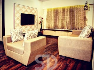 T.V. Unit and Formal Sofa Seating arrangement:  Living room by SUMEDHRUVI DESIGN STUDIO