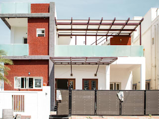 Frontage:  Houses by Studio Madras Architects