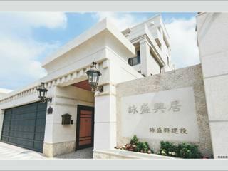 Classic style houses by 詠盛興營建機構 Classic