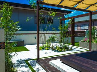 タイルテラス: 株式会社 岡本ガーデンが手掛けた庭です。