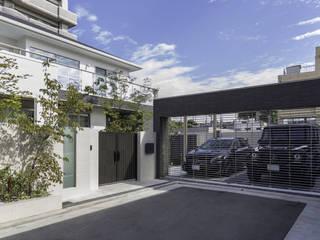カーゲート: 株式会社 岡本ガーデンが手掛けた家です。