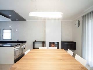 Dining room by Marianna Porcellato Porvett