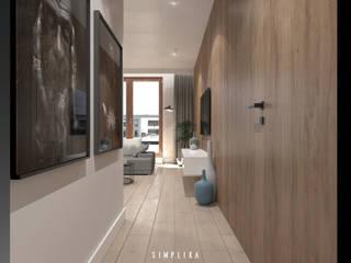 Pasillos, vestíbulos y escaleras de estilo moderno de SIMPLIKA Moderno