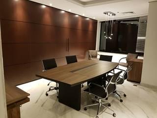 Sindona Advocacia: Espaços comerciais  por B+M Arquitetos Associados,Moderno