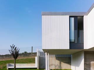 Modern houses by ADDOMO Modern
