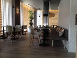 Pizzaria Il Fiume em Braga: Espaços de restauração  por atmospheras | atelier de interiores