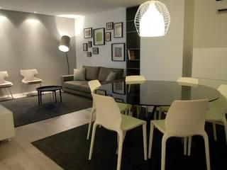 Sala de jantar e sala de estar: Salas de jantar  por atmospheras | atelier de interiores
