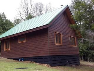 Refugio Rucue Casas de estilo rústico de San Cristobal hnos constructora Rústico