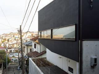 永田の住宅 The house in Nagata モダンな 家 の 栗原正明建築設計室 モダン