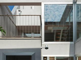 patio juan marco arquitectos Casas de estilo industrial