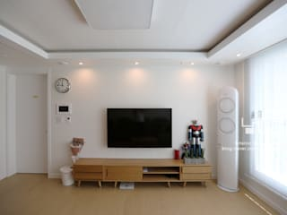 Living room by 남다른디자인,