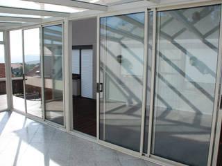 Wintergarten auf Dachterrasse Schmidinger Wintergärten, Fenster & Verglasungen Moderner Wintergarten Glas Grau