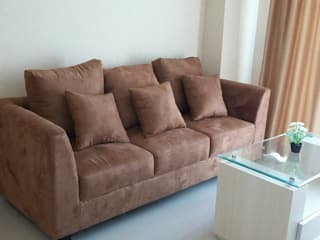 Interior Apartemen 2 Bedroom Kalibata City CV TRIDAYA INTERIOR Living roomSofas & armchairs