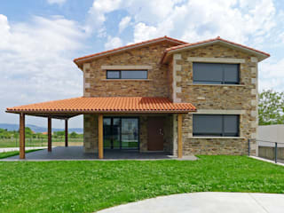 AD+ arquitectura Rustic style house Stone