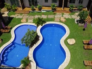 Piscinas de estilo tropical de Crystal Pool Tropical