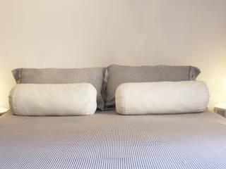 All in one: Camera da letto in stile  di studio ferlazzo natoli