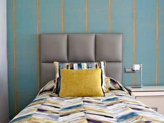 Dormitorio juvenil con textiles turquesa y ocre: Dormitorios infantiles de estilo  de Villalba Interiorismo