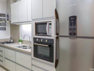 Cozinha Clean: Cozinhas  por Mariana Bertelli Arquitetura e Interiores