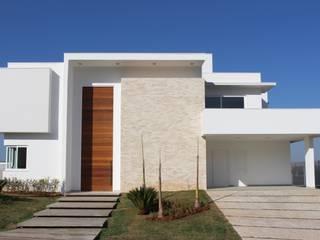Residência Condomínio Fazenda SerrAzul _ AS Casas modernas por Araujo Moraes Engenharia Arquitetura Moderno