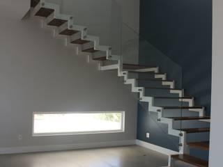 Residência Condomínio Fazenda SerrAzul _ AS Salas de estar modernas por Araujo Moraes Engenharia Arquitetura Moderno