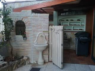 Estate è...mangiare all'aperto! Balcone, Veranda & Terrazza in stile rustico di T.A. arredo_arredamento su misura Rustico