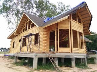 Log Home ติดมอเตอร์เวย์ โดย Sukjai Logcabin Partnership คลาสสิค